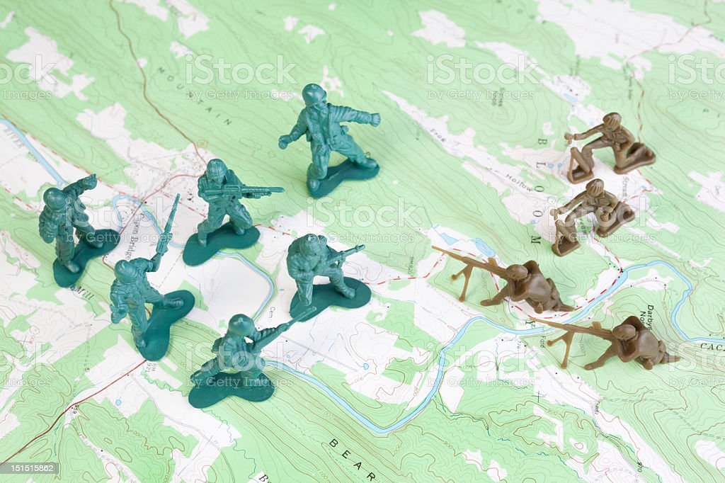 Plastic Army Men Fighting on Topographic Map General's View stock photo