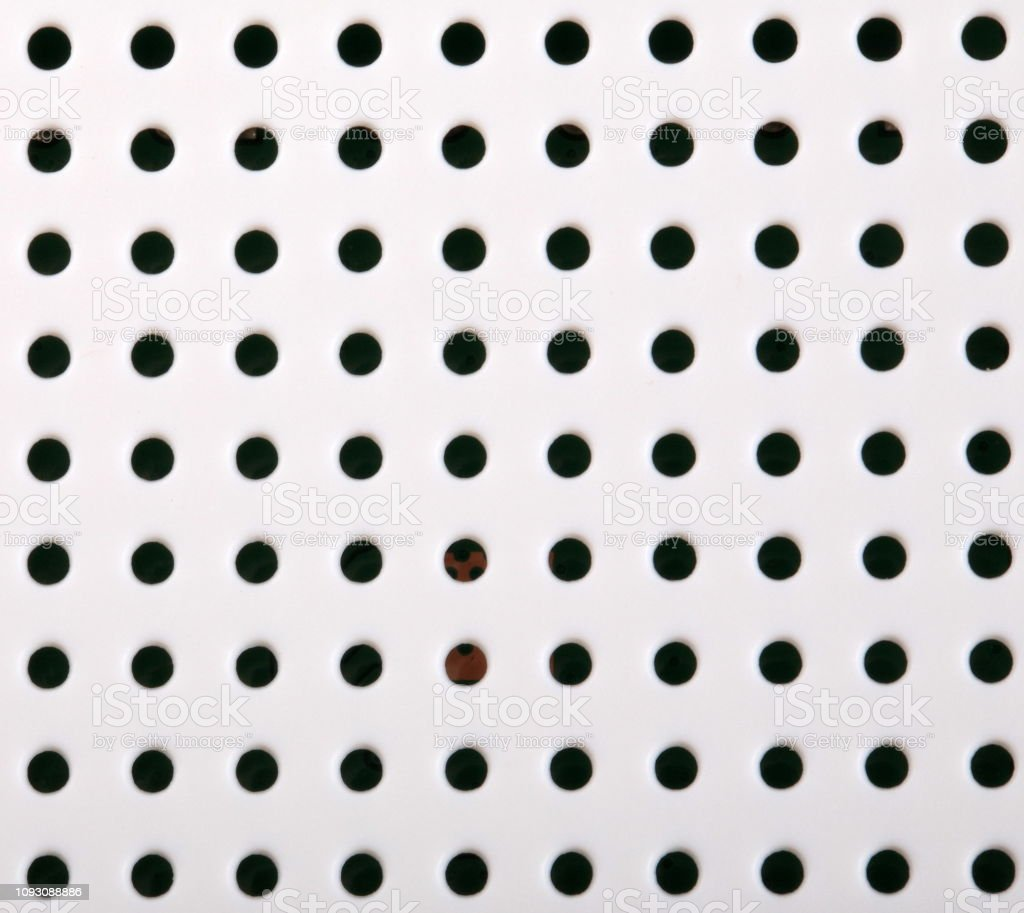 plastic background with holes stock photo