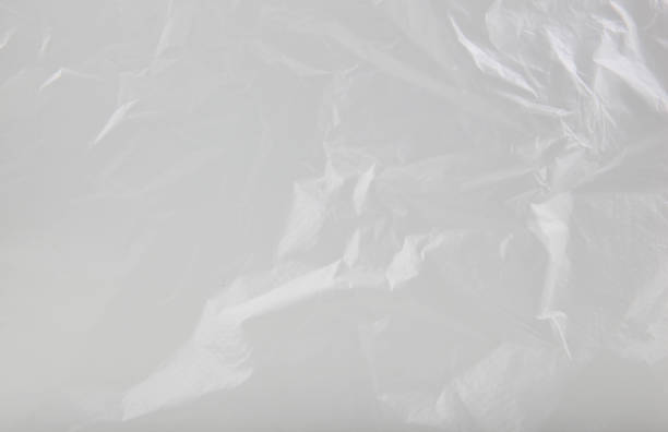plastic bag background - plastic stock pictures, royalty-free photos & images