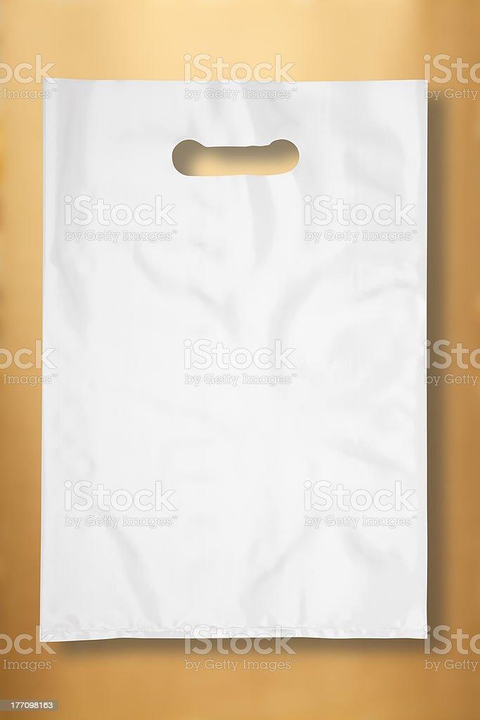 Plastic bag on gold stock photo