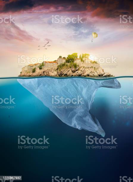 Photo of Plastic bag with island floating in the sea