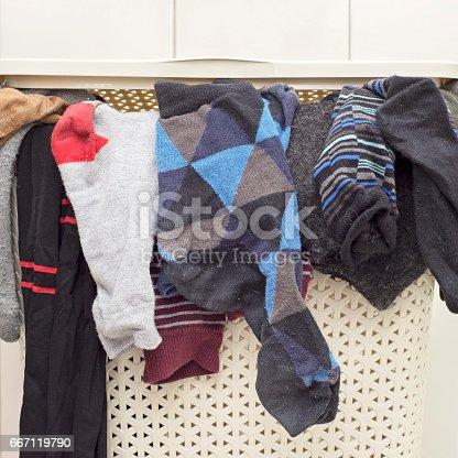istock plastic basket full of socks 667119790