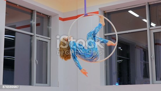 629965740 istock photo Plastic beautiful girl gymnast on acrobatic circus ring 876589982