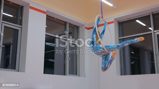 istock Plastic beautiful girl gymnast on acrobatic circus ring 876590014