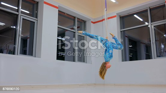 istock Plastic beautiful girl gymnast on acrobatic circus ring 876590120