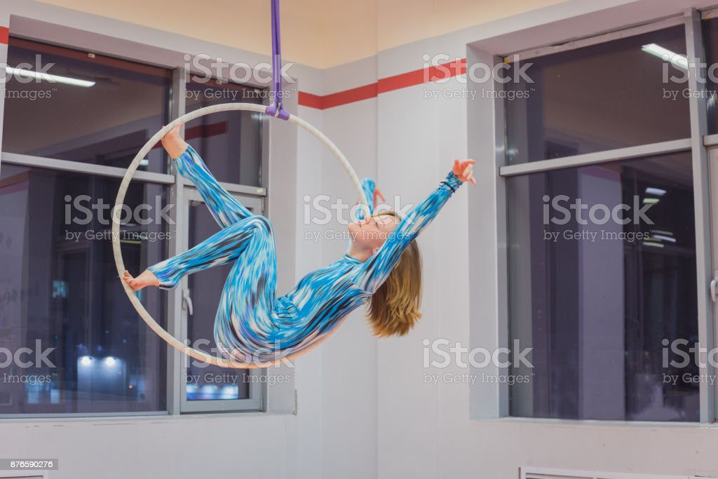 Plastic beautiful girl gymnast on acrobatic circus ring stock photo