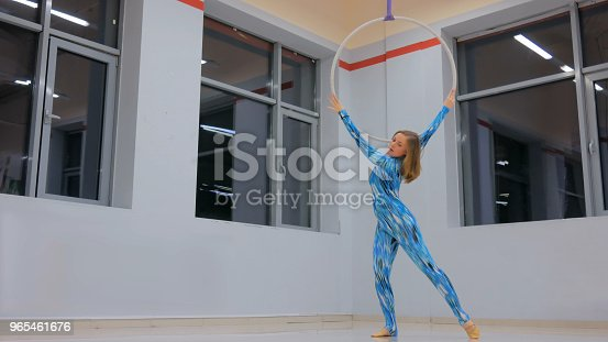 629965740 istock photo Plastic beautiful girl gymnast on acrobatic circus ring 965461676