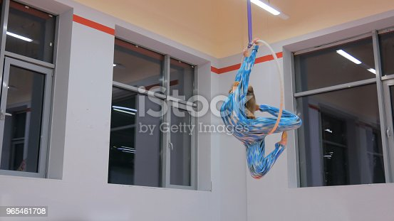 629965740 istock photo Plastic beautiful girl gymnast on acrobatic circus ring 965461708