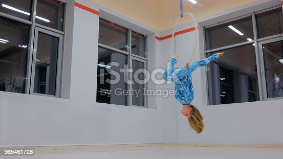 629965740 istock photo Plastic beautiful girl gymnast on acrobatic circus ring 965461726