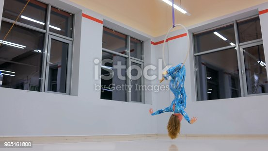 629965740 istock photo Plastic beautiful girl gymnast on acrobatic circus ring 965461800