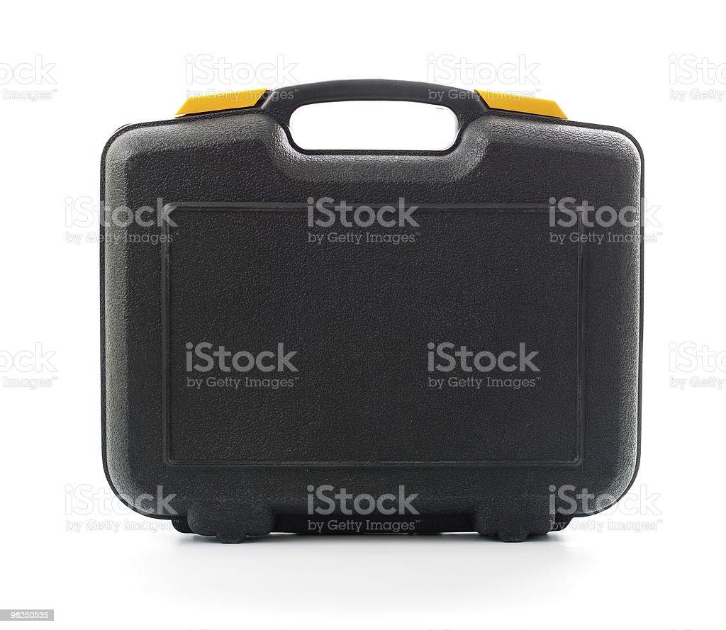 Involucro nero di plastica con strumenti isolati su bianco foto stock royalty-free