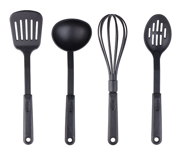 plastic black kitchenware set - keukengereedschap stockfoto's en -beelden