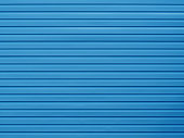 Plastic board blue wall texture. Building background