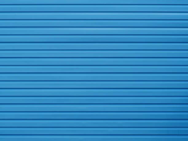 kunststoffplatte blaue wand textur. gebäude-hintergrund - kunststoff farbe stock-fotos und bilder