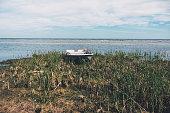 istock Plastic boat on the Baltic Sea coast 1290508291