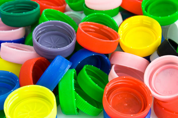 plastic bottle caps background - plastic cap stock pictures, royalty-free photos & images