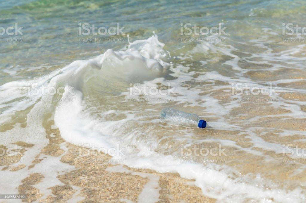 Plastic bottle floating on the sea. stock photo