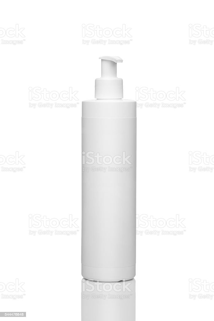 Plastic bottle for liquid cosmetic isolated on a white background стоковое фото