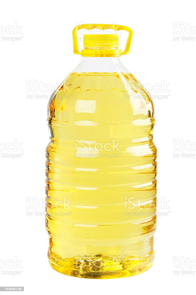 Plastic bottle of oil with yellow lid and handle royalty-free stock photo