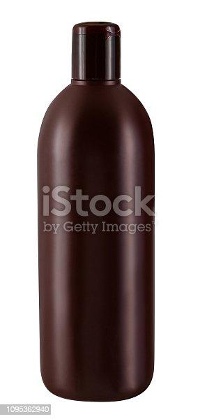 Brown plastic bottle of shampoo