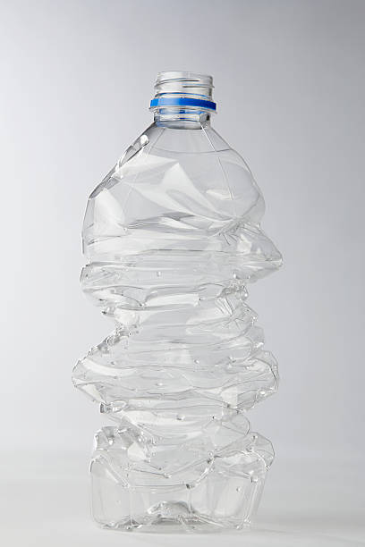 plastic bottle - crush stock pictures, royalty-free photos & images