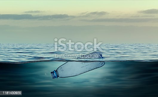 Plastic bottle, pollution that floats in the ocean.