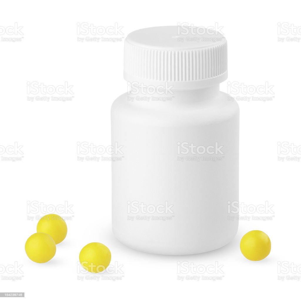 Plastic bottle with yellow vitamins royalty-free stock photo