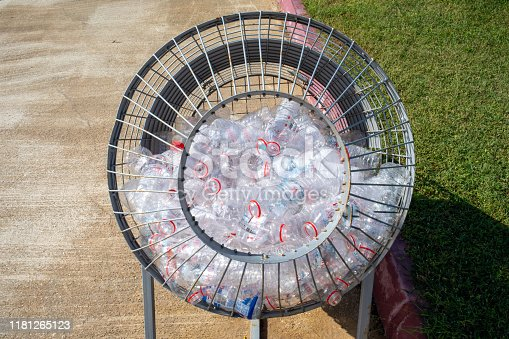 plastic bottles are collected in a metal basket