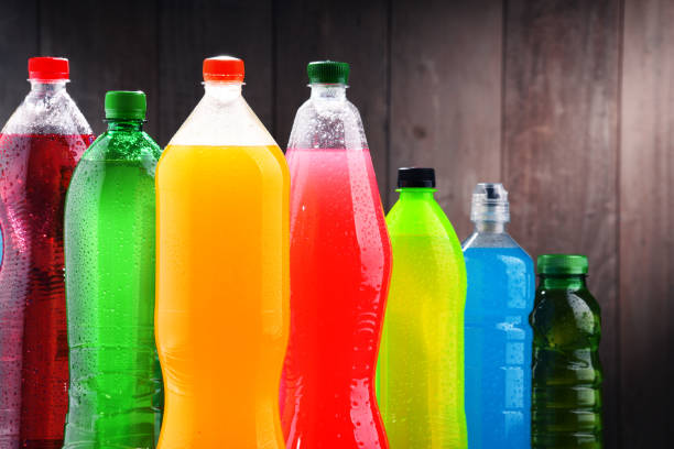 plastic bottles of assorted carbonated soft drinks - bottle soft drink foto e immagini stock