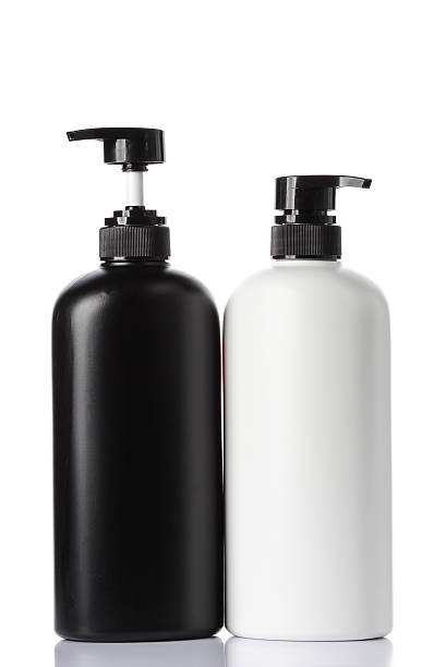 plastic bottles of body care and beauty products on white stock photo