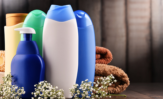 istock Plastic bottles of body care and beauty products 941545576