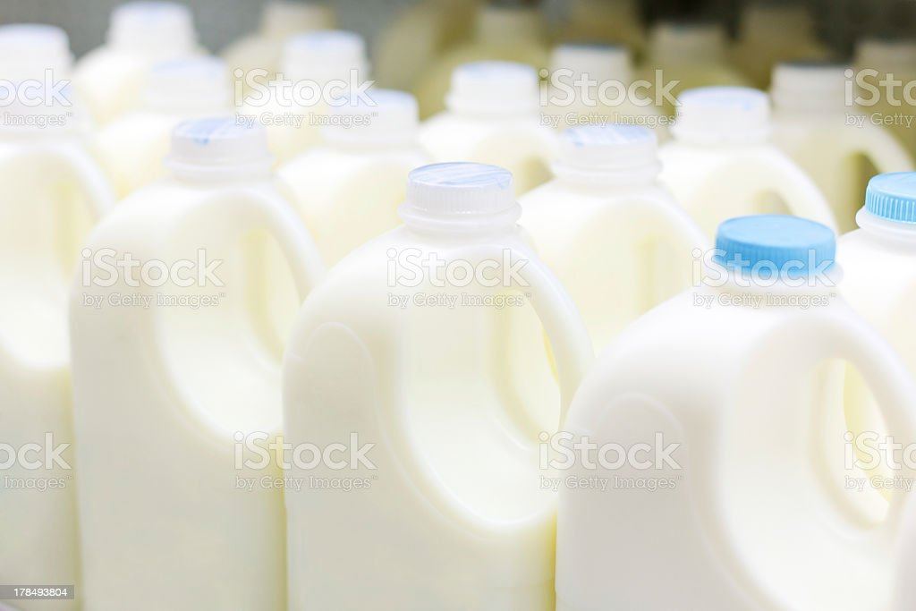 Plastic bottles of milk on factory production line stock photo