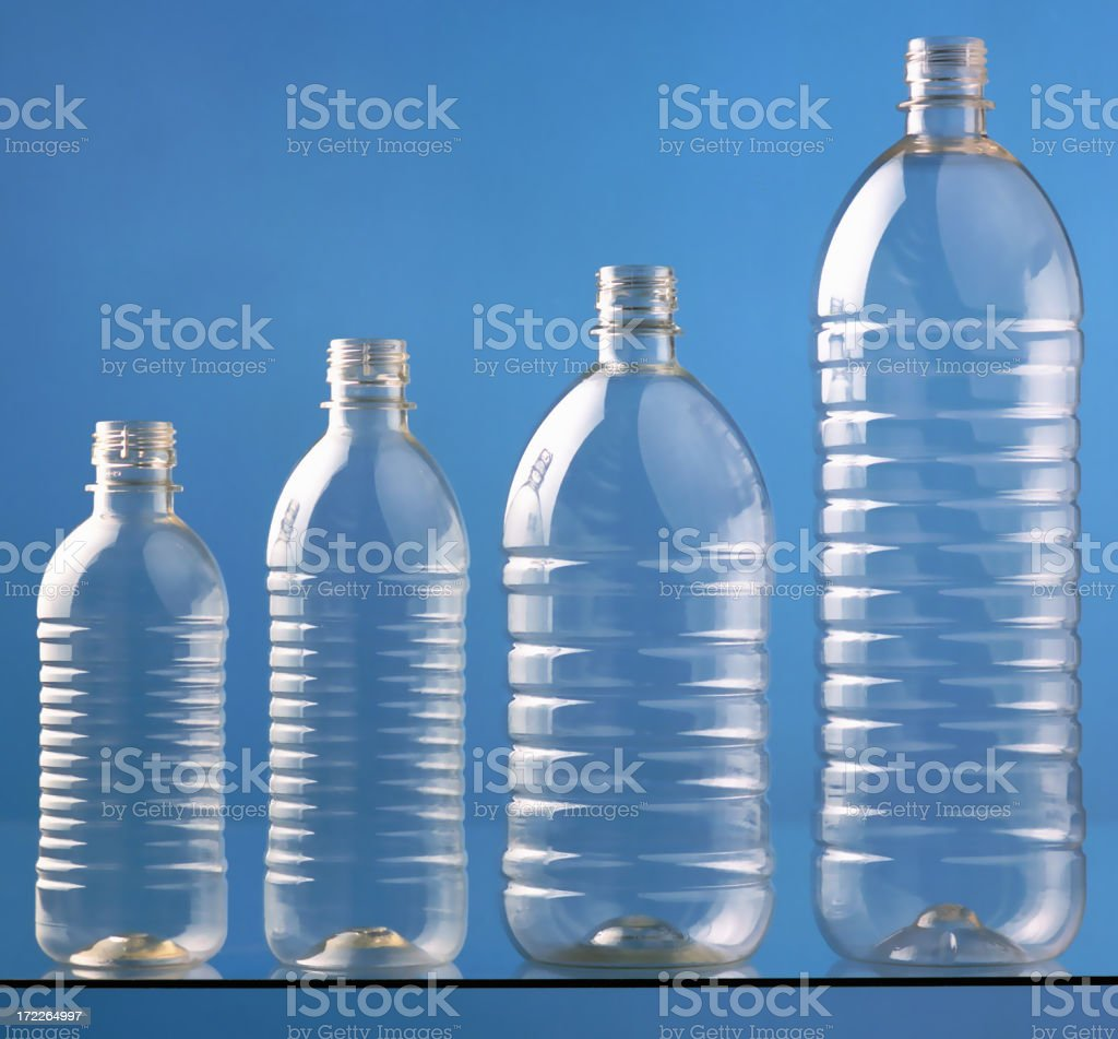 Plastic Bottles on Blue Background royalty-free stock photo