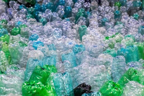 pet plastic bottles stacked. plastic recycle system - economia circular imagens e fotografias de stock