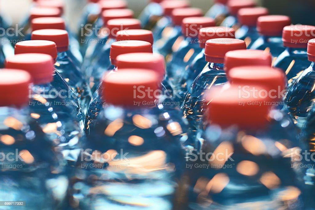 Plastic bottles with red caps stock photo