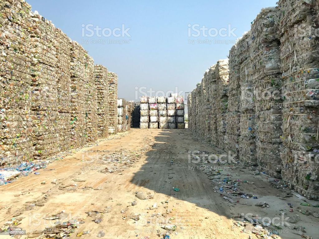 Plastic bottles,compressed into bales and ready for recycling stock photo