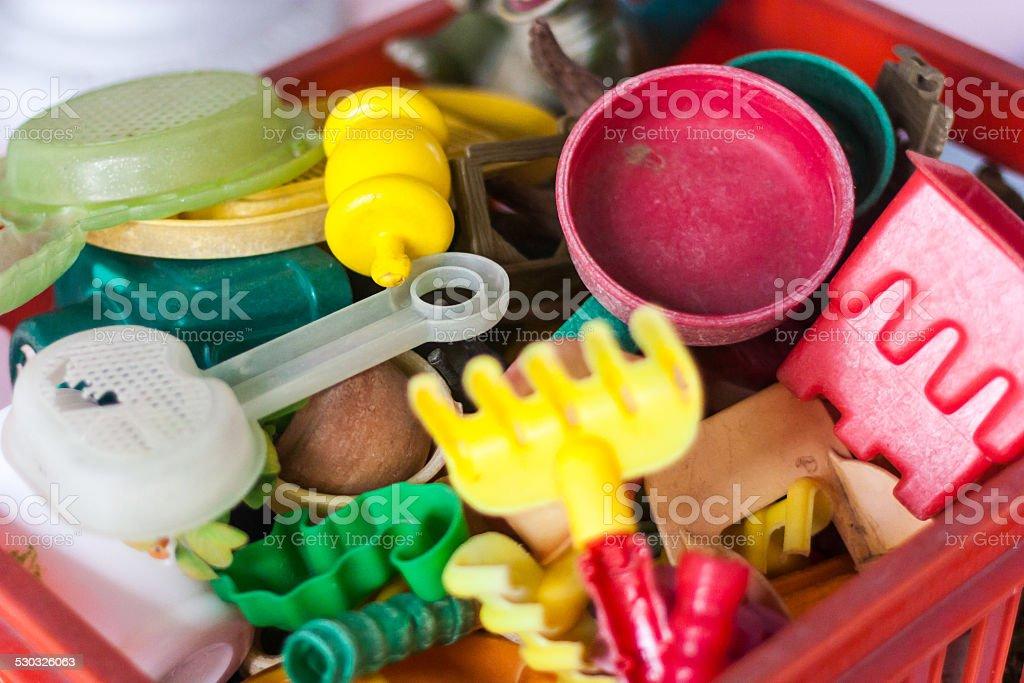 Plastic box full of old sand toys stock photo
