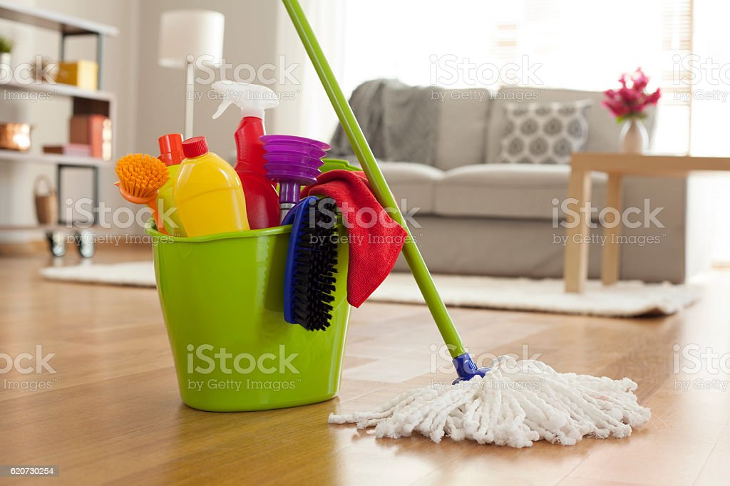 Plastic bucket with cleaning supplies in home stock photo