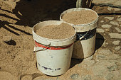 Plastic buckets with sand in construction site