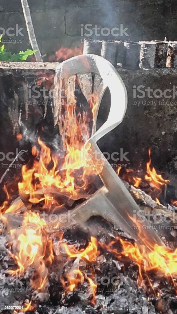 A plastic chair burning on bonfire royalty-free 스톡 사진