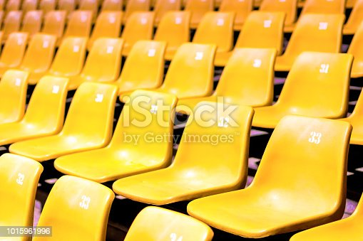 Plastic chair With all numbers In large conference room