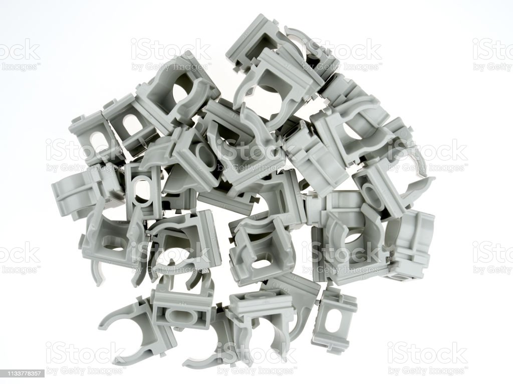Plastic clamps for electrical tubing stock photo