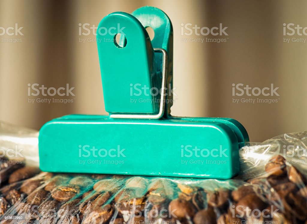 Plastic clip sealing coffee tight in a bag stock photo