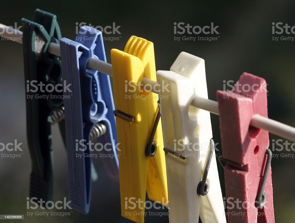 Plastic colored clothes pegs royalty-free stock photo