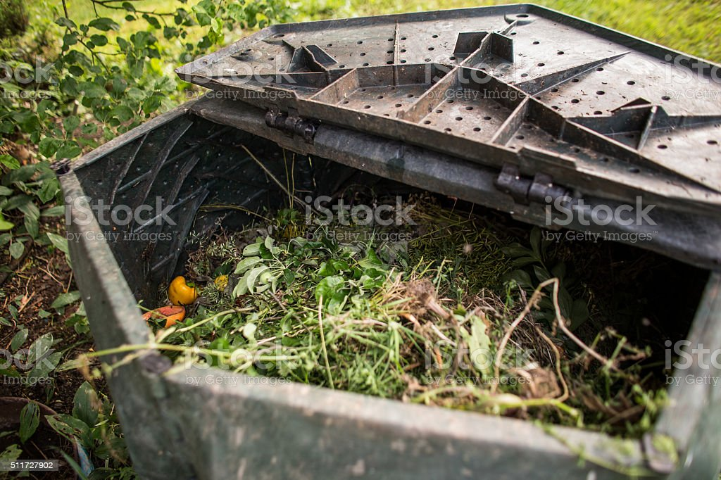 Plastic composter in a garden stock photo