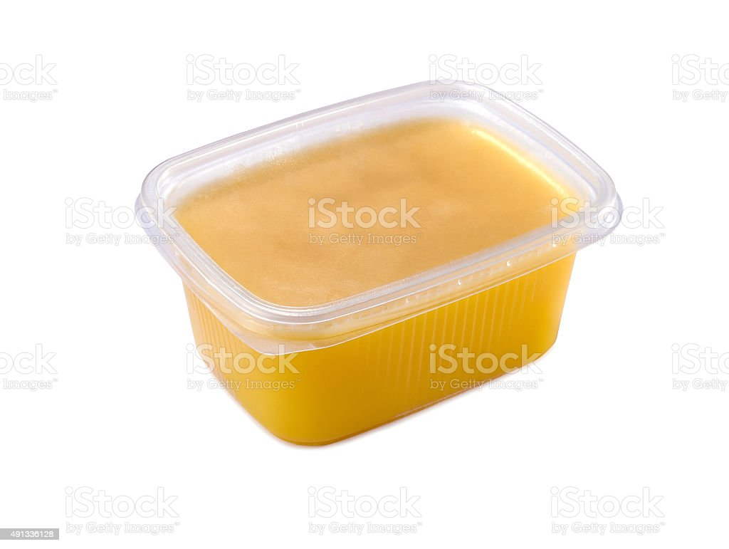 plastic container with ghee butter isolated stock photo