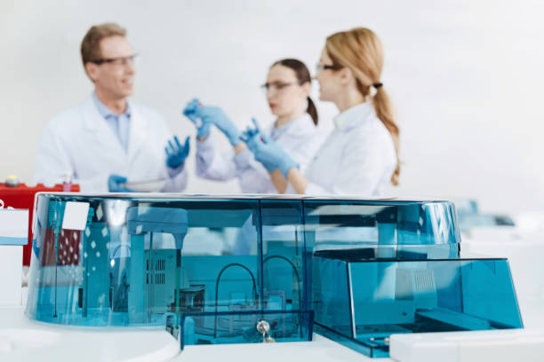 Plastic cover being the part of workplace Conference of specialist doctors. Serious colleagues standing next to each other while discussing and actively gesticulating dna purification stock pictures, royalty-free photos & images