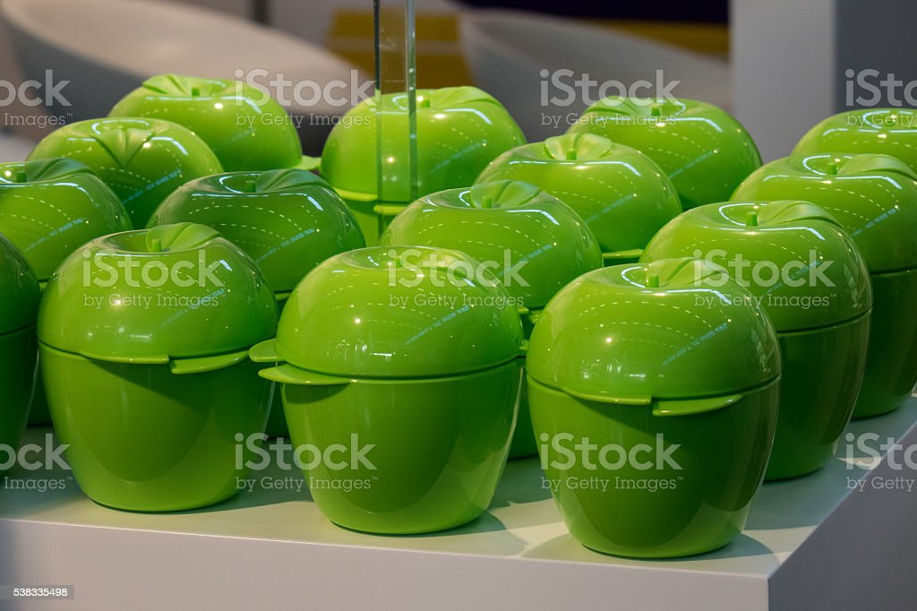 Plastic cups in the shape of green apples stock photo