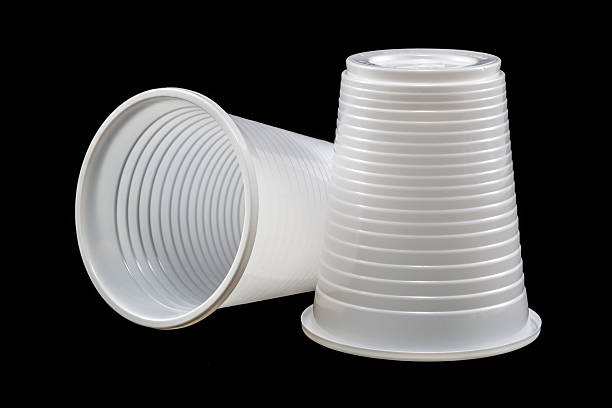 Plastic cups on black stock photo
