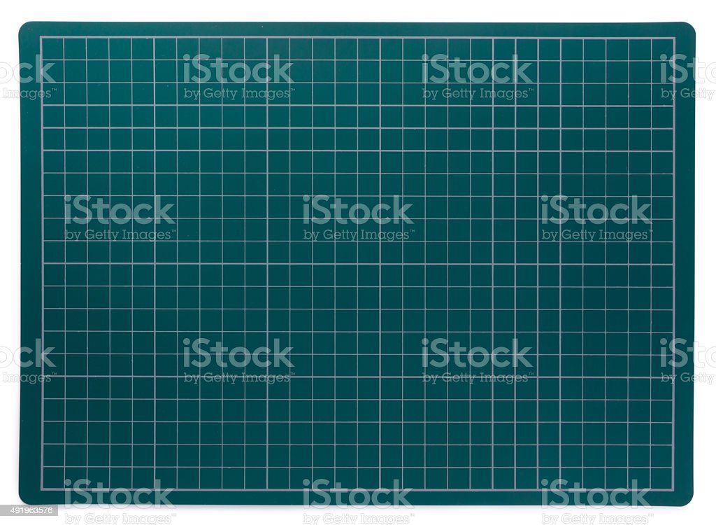 Plastic cutting mat isolated on white. stock photo